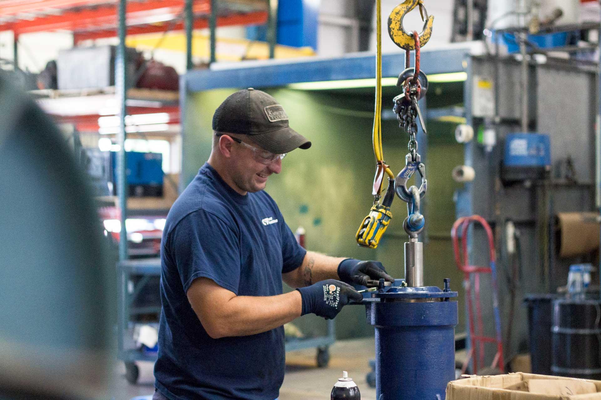 crane_employee_working_on_part